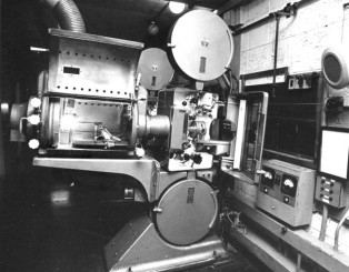 600 Projection room, showing the Phillips DP70 dual gauge 35 and 70mm projectors, with Peerless Magnarc carbon arc lamphouses of the COLUMBIA THEATRE, SHAFTESBURY AVENUE, LONDON, the name of the cinema when it opened in 1959